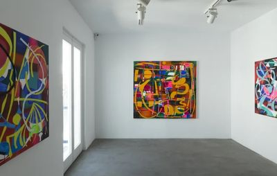 installation view of three colourful paintings hung each on a different white wall