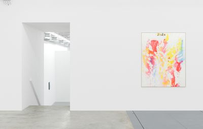 installation view of an abstract colourful painting hung on an otherwise bare white wall