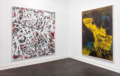 installation view of two paintings by different artists on adjacent white gallery walls