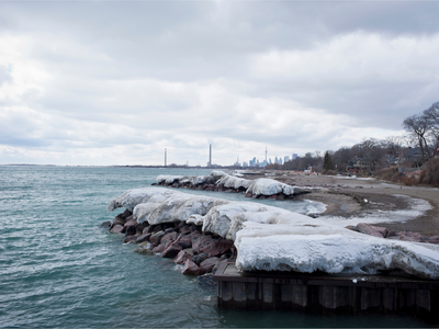 Looking back at Toronto from a snowy beach