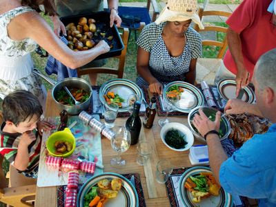 A family enjoying a roast meal for Christmas lunch in New Zealand