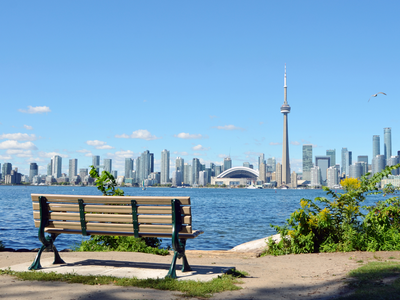 Looking out at the Toronto skyline from behind a park bench on the Toronto Islands.