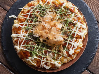 "Okonomiyaki, a Japanese ""pancake"" from Osaka"
