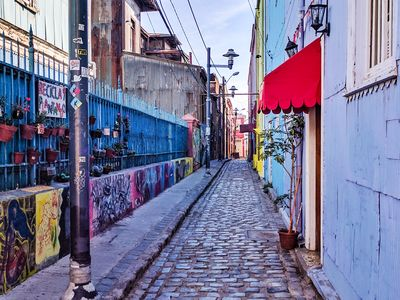 An art-filled laneway in Valparaiso, Chile