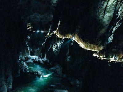 The lit pathway through the Skocjan Caves