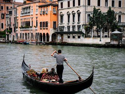 Gondola in a canal in Venice