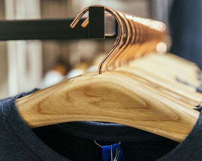 Close-up shot of a line of wooden clothes hangers.