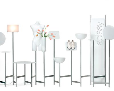 Miscellaneous white items such as tables, lamps, and a mannequin are lined against a white background.
