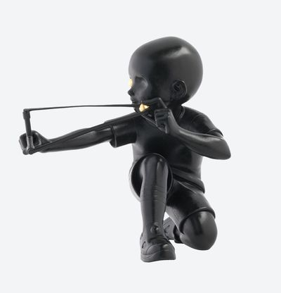 James Jean black sculpture of a boy with a slingshot and a golden eye