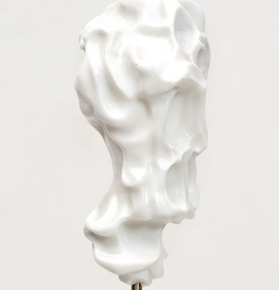 white marble sculpture resembling a face on a bronze pole by Kevin Francis Gray - close up