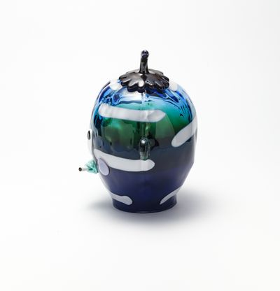 Glass head with hat and cigarette, Lil-Lorda (Green/Blue) by Joakim Ojanen