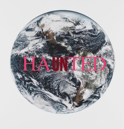 Image of earth with pink text across, Haunted by Cali Thornhill Dewitt