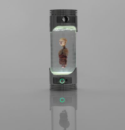 Figure suspended in light-up canister, Gong Tau Alien by Lu Yang