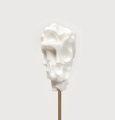 white marble sculpture on a steel stick by Kevin Francis Gray