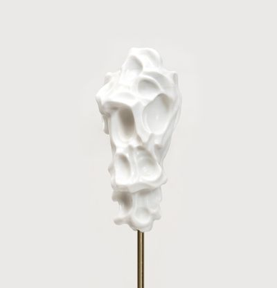 white marble sculpture resembling a face on a bronze pole by Kevin Francis Gray - front close up
