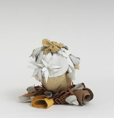 Soft sculpture of leather and cloth, Dove by Tau Lewis
