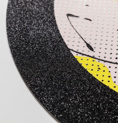 detail of black glitter border of a circular print