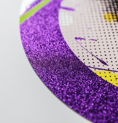 detail of a corner of a circular print with purple glitter