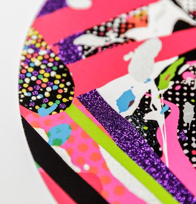 close-up of a colourful patterned print with purple glitter