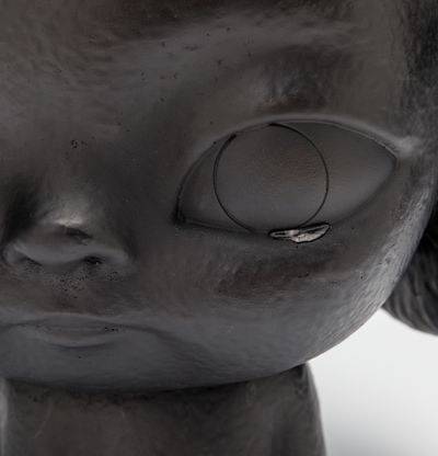 Bronze sculpture of person with tears, KIRA (Black) by Roby Dwi Antono - detail shot