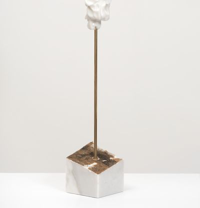 white marble sculpture on a bronze pole by Kevin Francis Gray - back view