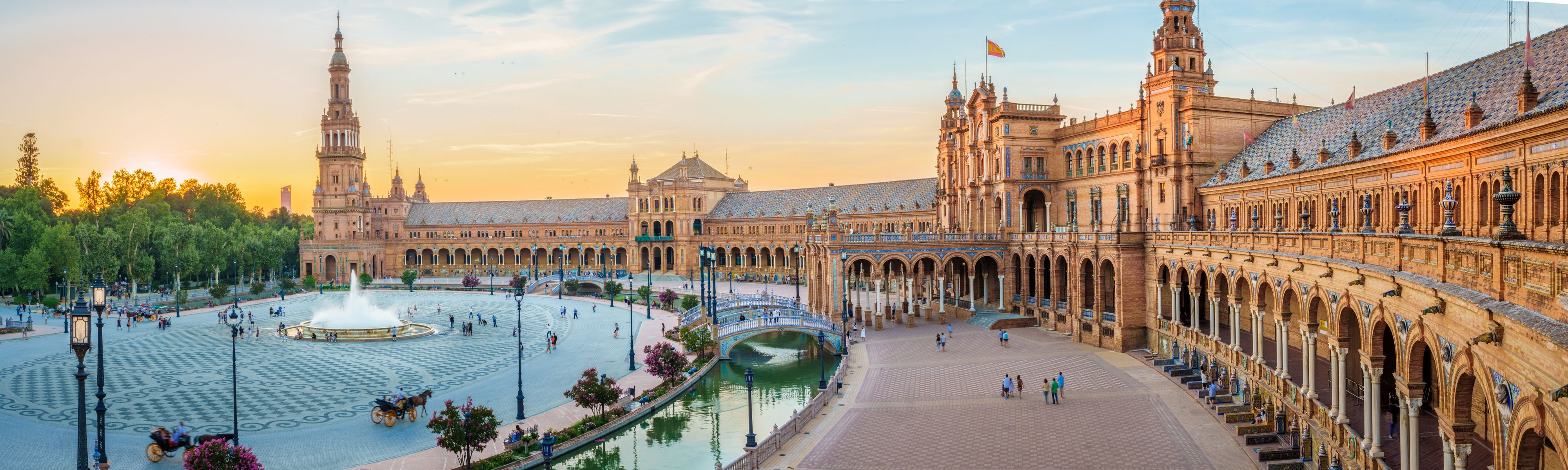 people walking around plaza de espana in seville