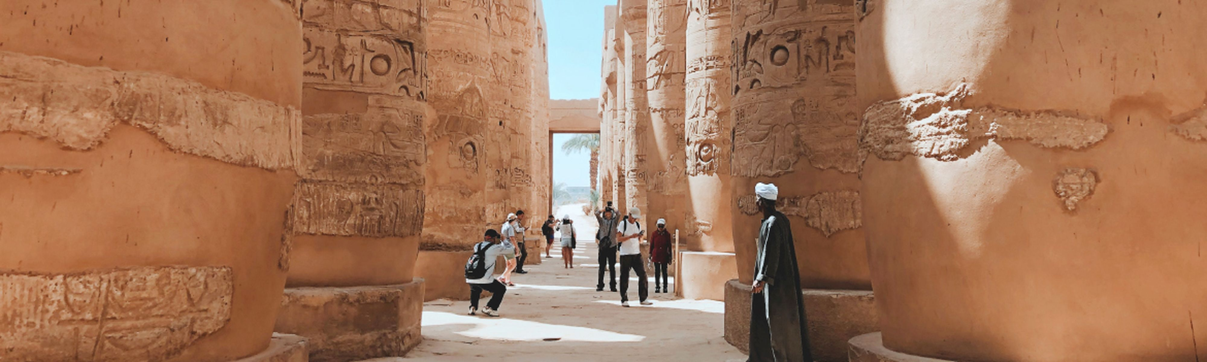 Group tour through Egyptian temple guard in Luxor, Egypt