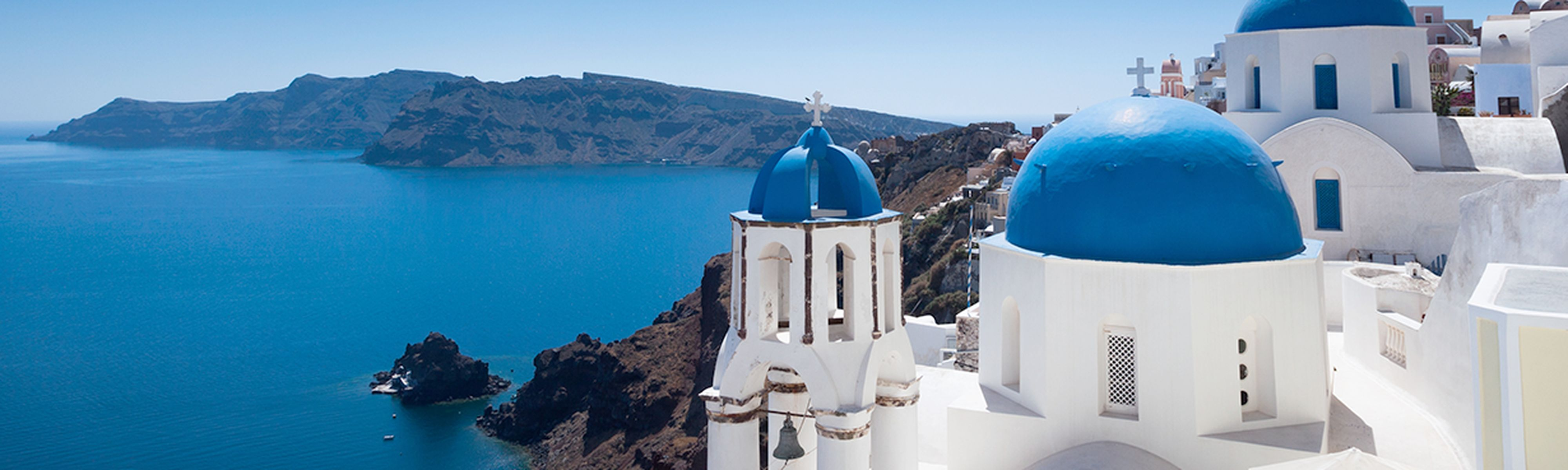 Blue and white domed churches on Santorini Greek Island