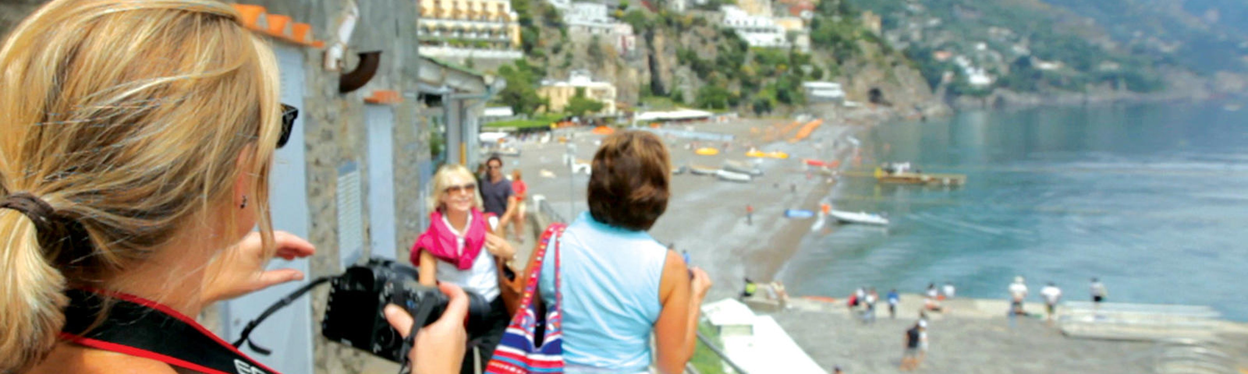 Group tour walking on coast of Positano in Italy