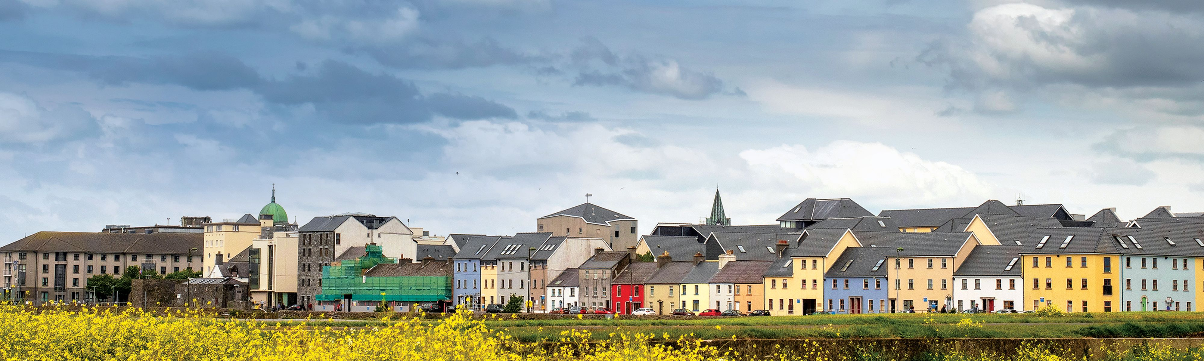 colorful houses along the coast in galway ireland