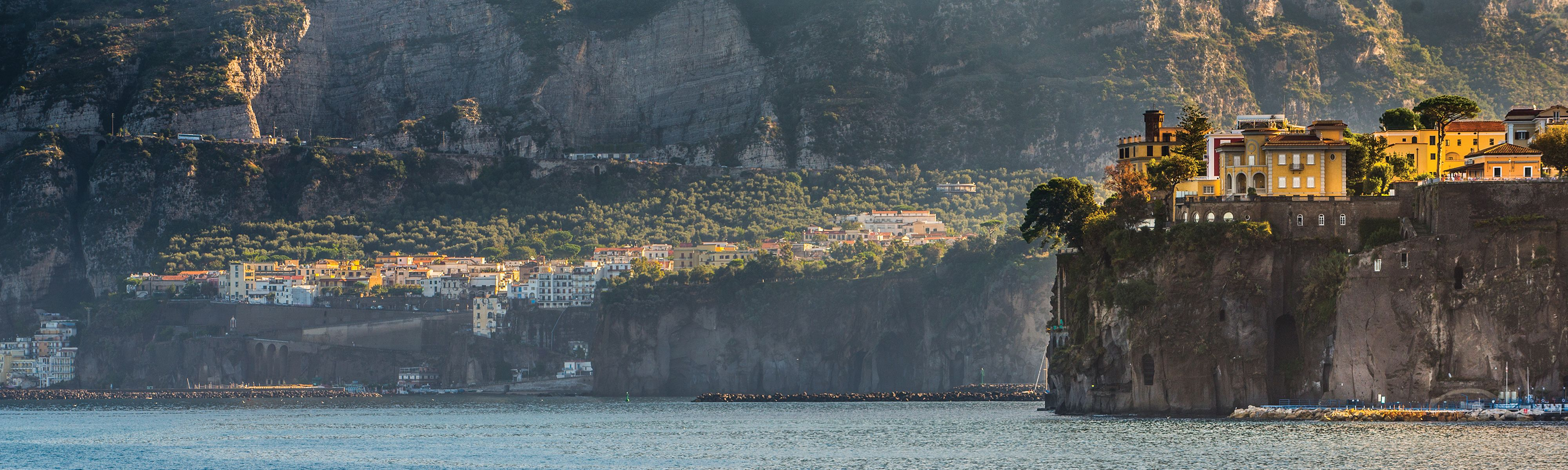 View of Sorrento coastline with yellow buildings in Italy