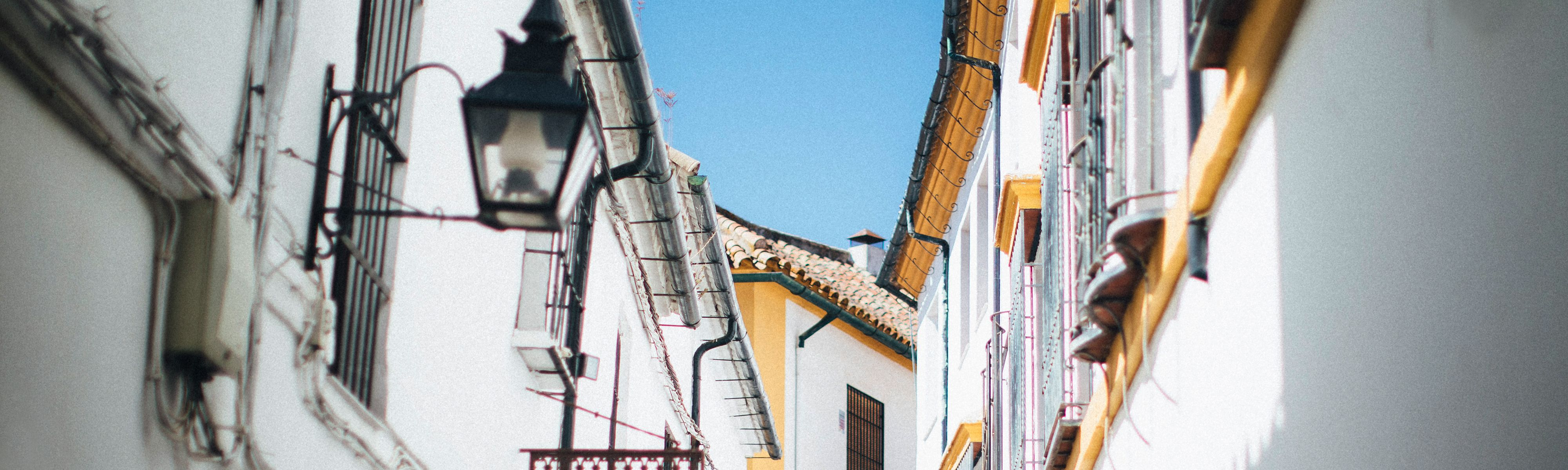 white building with bright yellow trim in spain