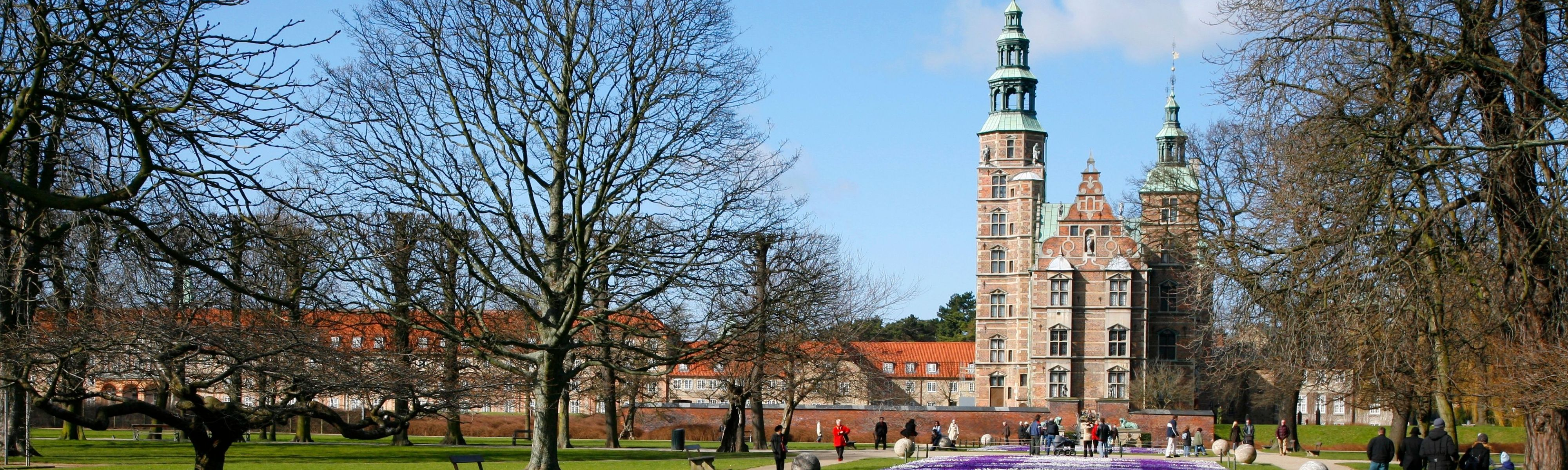 people walking around at rosenborg castle in the spring in copenhagen