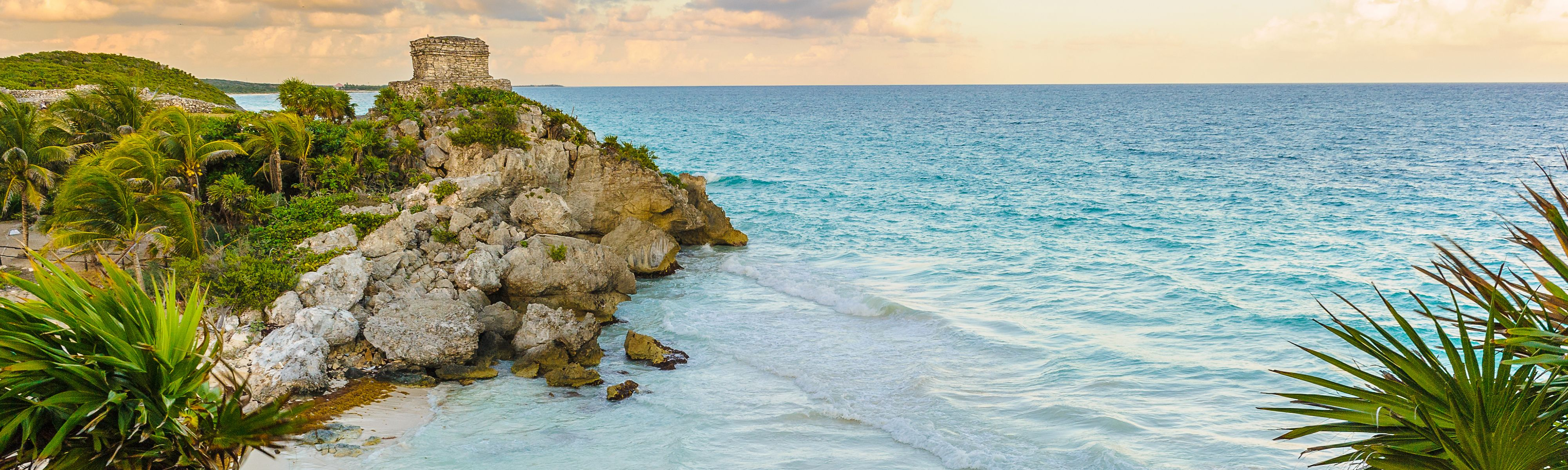Coast of ocean in Tulum, Mexico with view of Mayan Ruins site