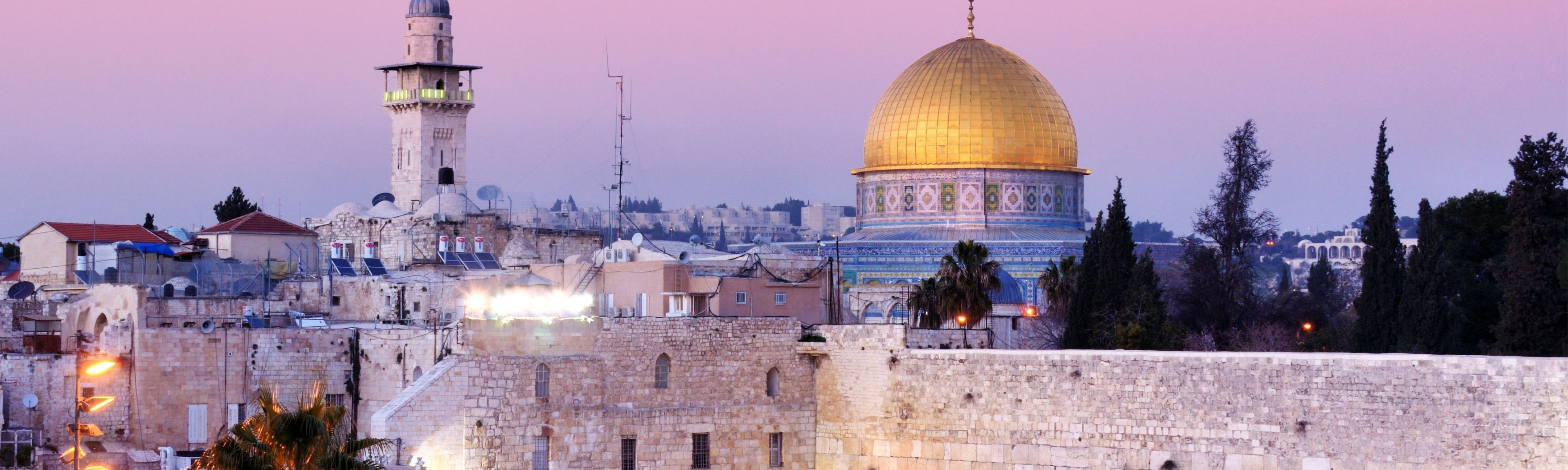 western wall and dome of the rock at sunset in jerusalem