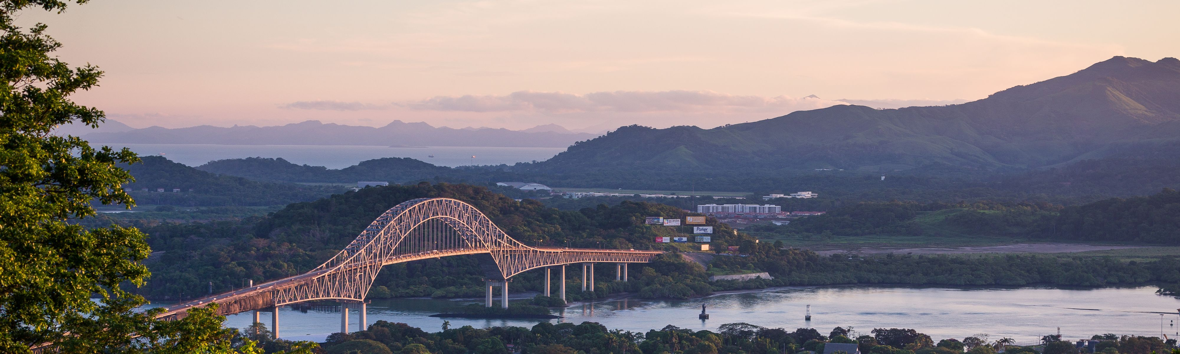 bridge over the panama canal in panama at sunset