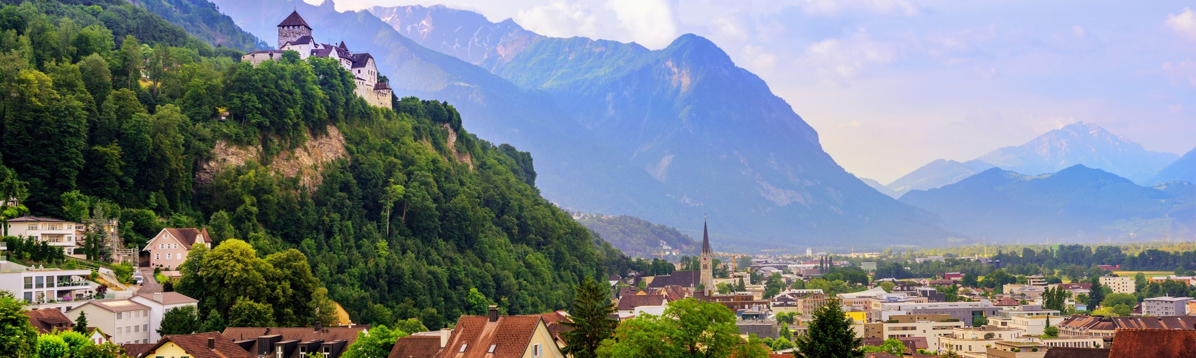 panoramic view of laduz village in liechtenstein surrounded by mountains