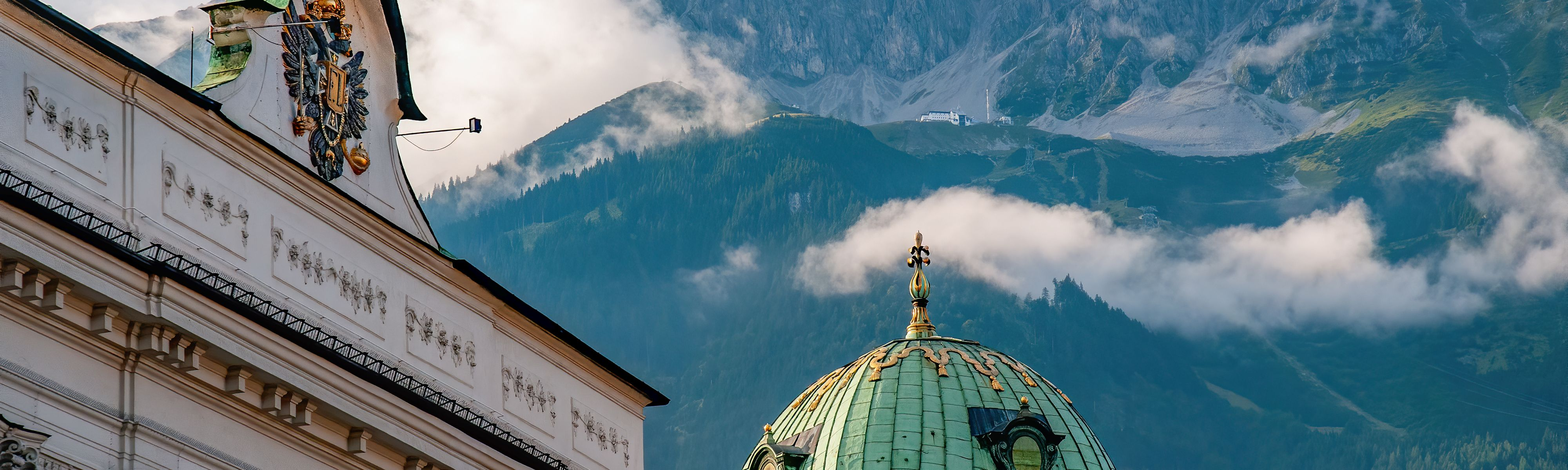 teal roofed heritage building at the alpine foothills in innsbruck austria