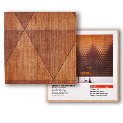 A square tile sample showcasing a wooden triangular patterned Infused Veneer material. Another square tile is underneath the first one showcasing how the tile would look across a wall of a room.