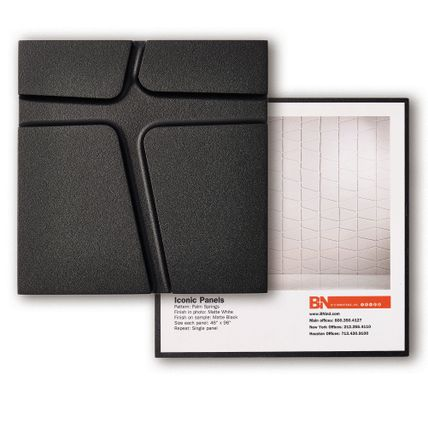 A black square tile with cross shaped linear patterning showcasing the Infused Veneer sample. Another square tile is behind it showcasing how the tile sample would look spread across a wall of a room.