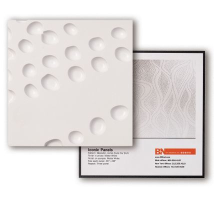 A white square tile with a circular divot patterning showcasing the Infused Veneer sample. Another square tile is behind it showcasing how the tile sample would look spread across a wall of a room.