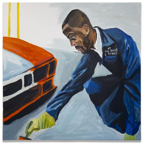 Man in blue overalls painting the front of a car orange