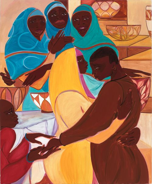 woman in yellow embracing a man in brown with three women all with blue headscarves behind them