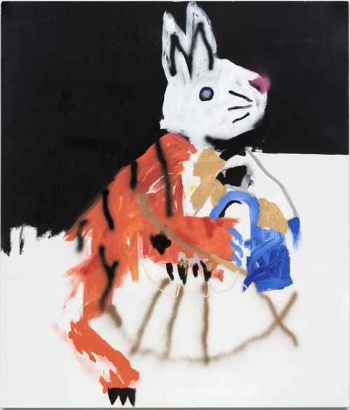 white rabbit with the fur of a tiger on its body