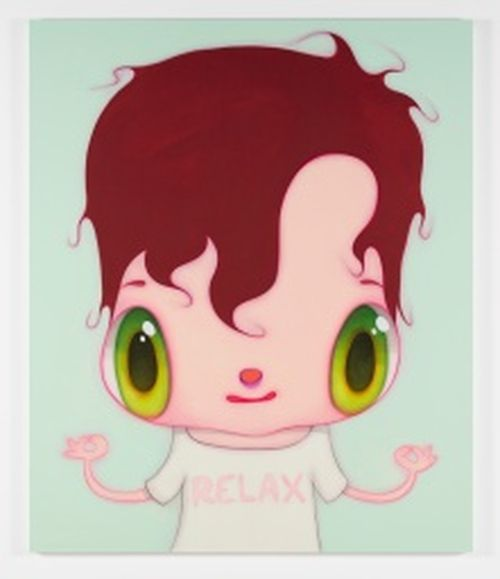 brown haired child with big green eyes wearing a t-shirt that reads 'RELAX' whilst holding his hands upwards