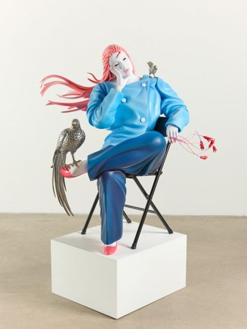 fibreglass sculpture on white plinth of figure with pink hair in blue clothes with bird on their foot