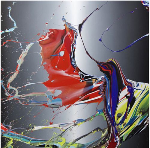 black and grey background with splashed red, blue and yellow paint on it