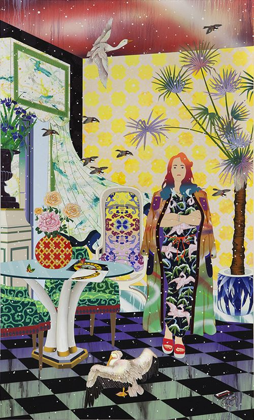 Woman stood with arms crossed in a room with a pelican, a vase of flowers on the table, a tree growing from a plant pot, and more birds flying in through an open window