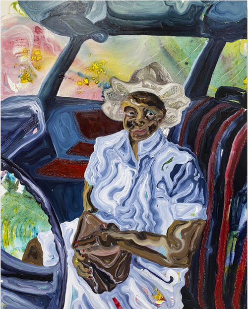 woman in a hat sits in the front seat of a car