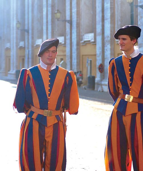 two italian men dressed in traditional yellow blue and red stripped outfit